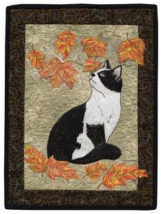 """Falling Leaves"" by Barbara Beaumont, AAQI. Designer: Ruth Soffer, Dover Publications Cats Stained Glass Coloring Book.  Free motion thread painted."