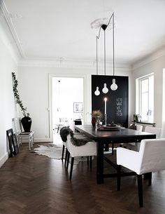 This is an awesome mix of dark wood floors, a long table like ours, decorative molding, and cool lighting...basically all things we love.