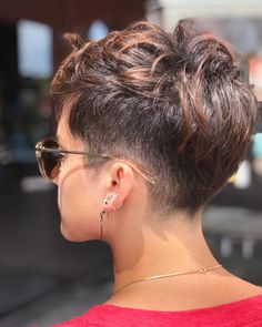 Dark undercut pixie with shaved nape.