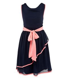 Emma's dress for the wedding.  Navy blue with coral trim.  Tying it in back instead.
