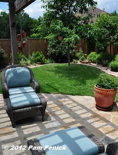 Inviting patio and small lawn surrounded by colorful, water-thrifty beds, the Zadock Woods Garden, Gardens on Tour 2012