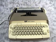 Sold  Vintage 1970s  SMITH-CORONA  Electric Typewriter  CORONET  with Manual and Case.