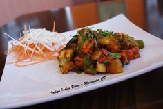 Chili Paneer (Med Spicy) - Cheese tossed with onion, bell pepper, ginger, soya and red chili