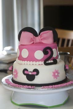 Pink Mouse cake - The cake is a chocolate chip cake with buttercream icing and the cupcakes are yellow cake with buttercream. All decorations are fondant.