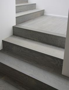 gray wood stairs that turn a corner. stain color. Exquisite Surfaces