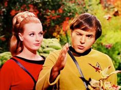 "Martha Landon (Celeste Yarnall) seems bemused by Chekov (Walter Koenig) in ""The Apple"" episode of Star Trek."