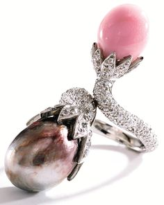 Natural pearl, conch pearl, and diamond ring.