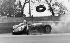 Tony Bettenhausen slaps the wall hard in 1956.