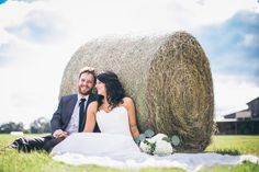 wedding photography | field | hay bale | bride and groom | oak hollow farm