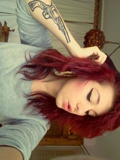 Love dark red hair with thick winged liner and hoops!