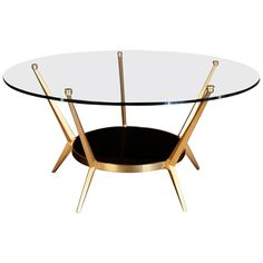 1950s Round Coffee Table by Angelo Ostuni | From a unique collection of antique and modern sofa tables at https://www.1stdibs.com/furniture/tables/sofa-tables/