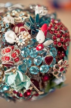 Bouquet made out of brooches instead of flowers, if we could find pretty red and black jewels?