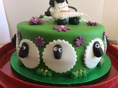 Sides of the cake surrounded by sheep