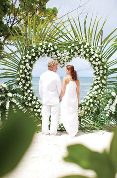These tropical beach colors are gorgeous and perfect for a beach wedding! The flower petals, wedding chairs and flower arrangements are so bright, colorful and happy. Wedding Knot, Wedding Ceremony, Destination Wedding, Reception, Wedding Beach, Tropical Floral Arrangements, Flower Arrangements, Stage Decorations, Wedding Decorations