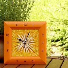 Hodiny - Oranžové II... Představuji vám hodinyOranžové II .... Nástěnné hodinyjsou laděnyvodstínech oranžové a žlutébarvy, doplněné barvou bílou a hnědou. Na vnitřní desce hodin jevytvořen plastický efekt, na kterém je provedena malba akrylovými barvami,. Rámeček je namalovánvýrazným odstínem oranžové barvy, skrz malbu prosvítá výrazná struktura ...