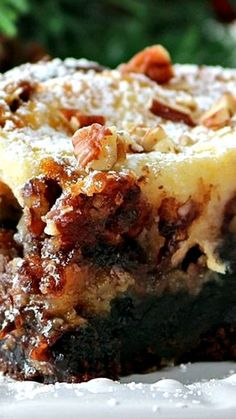A fudge brownie layer, topped with a pecan pie filling and then a cheesecake layer. Ooey gooey cake at it's best!