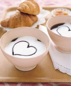 Croissants with cafe au lait and chocolate hearts