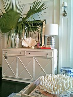 great tabletop display. love the palms and oceanic touches.
