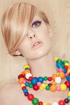 Edible jewelry -gumball necklace -- there is also a taffy choker and a candy necklace barrette. So fun!