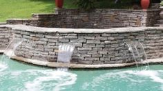 Three sheer descent Waterfalls add a nice natural feel to this Pool. Each Waterfall is individually lit from below. Natural Swimming Pools, Ponds, Waterfalls, Patio, Nice, Outdoor Decor, Nature, Natural Pools, Naturaleza