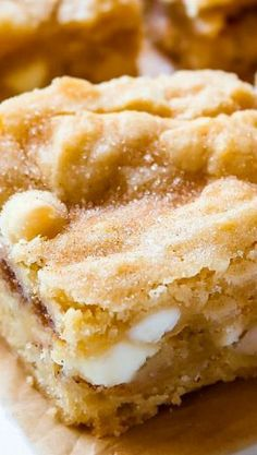 A cross between a chewy blondie and moist butter cake, these blondies are studded with white chocolate chips and ribboned with sweet cinnamon sugar!