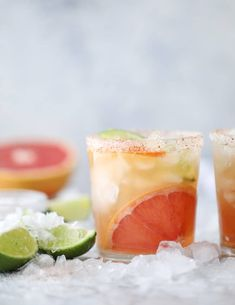 This kombucha mocktail is made with three different freshly squeeze juices: grapefruit, lime and orange! It's filled with a citrus or ginger kombucha, ice cold ginger beer, lots of crushed ice and citrus wedges. Then rimmed with a salty chili sugar that takes this mocktail over the top!