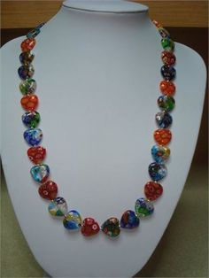 real venezia murano millefiori necklace in heart shapes, in sterling silver at 55 cm long and extra chain   measurement 22 inches long
