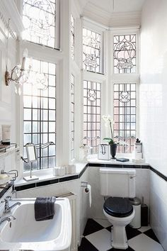 Light-filled black and white bath, gorgeous windows.