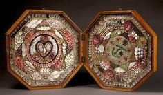 A nineteenth-century sailor's valentine with heart, anchor and floral symbols.