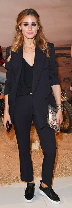 Who made  Olivia Palermo's black sneakers, pants, tank top, and sneakers?