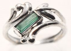 Sterling silver ring featuring a green tourmaline.  #unique #customjewelry #silver #ring #GoldcraftersCorner