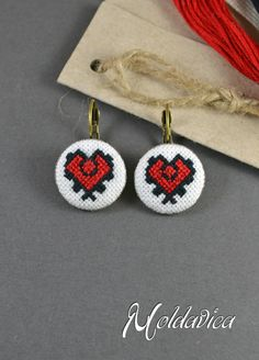 Earrings with embroidered symbol in red and black taken from a traditional Moldovan men's shirt. By Moldavica.