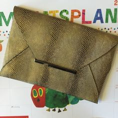 """BCBG  Gold Envelope Clutch New without tags! This has been hanging out in my closet wishing to be shown off  Gold envelope clutch. Measures approximately 11x8"""". Will ship with original bag protector. Price is firm BCBGMaxAzria Bags Clutches & Wristlets"""