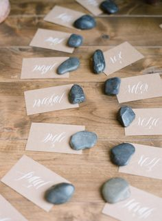 calligraphy + kraft + river rocks = simple and lovely escort cards goes with the tree center piece