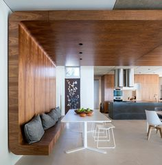 A curved wooden bench wraps around onto the ceiling and across the room.