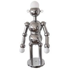 Torino Chrome Robot Lamp Large Size. Italy circa,1960's. | From a unique collection of antique and modern table lamps at https://www.1stdibs.com/furniture/lighting/table-lamps/