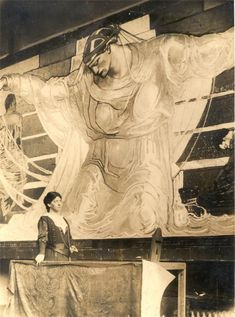 Violet Oakley at age 28, standing beside a portion of her 44-foot-wide mural, International Unity and Understanding, Pennsylvania Credit: Violet Oakley Papers, 1841-1981. Archives of American Art, Smithsonian Institution