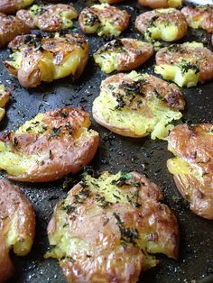 Roasted Smashed Potatoes with Herbs Add garlic and parmesan cheese on top Oh. my. hell.