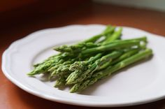 Asparagus A half-cup supplies 50% of your daily bone-building vitamin K and a third of your day's folate, it's a natural diuretic so it banishes bloating, too. Try this One-Pan Spring Chicken with Asparagus and Edamame.
