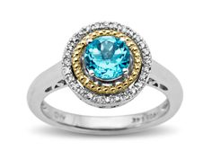 Concentric orbits center in on the glowing centerpiece of this captivating ring! A glowing 1 ct round-cut Swiss blue topaz is circled by a band of 14K gold and diamond accents all set in a ring crafted in sterling silver. Ring face measures 1/2 inches in diameter.