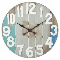 "Slatted wood wall clock with oversized numbering and a distressed finish. Product: ClockConstruction Material: WoodColor: MultiAccommodates: Batteries - not includedDimensions: 28.875"" Diameter x 1.75"" D"