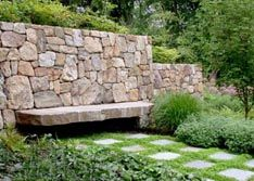 beautiful wall with stone bench