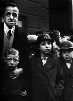 """Philip Jones Griffith: This group of school children with their teacher waiting to board a bus. 1952 """" Liverpudlians have always expressed an intensity rarely seen. Old Photography, Types Of Photography, Street Photography, Candle In The Dark, The Scorpio Races, Evelyn Waugh, Powerful Images, Great Photographers, Black And White Pictures"""