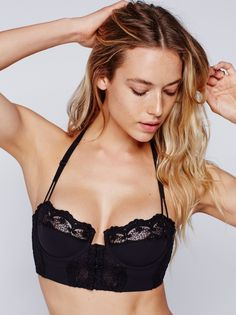 Reve De Toi Underwire Bra | Corset-inspired underwire bra featuring delicate lace trim with scalloped edges and overlay detailing. Dotted sheer mesh panel in back with a racerback and adjustable straps. Multiple hidden hook-and-eye closures in front.