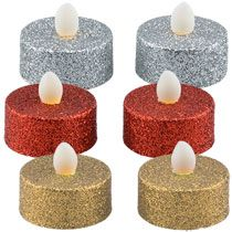 Brighten up the holidays with battery-operated tealight candles! Plastic 1.375-in. round candles have a glittery finish and a natural-colored flame with a flicker effect lasts up to 120 hours. A safe