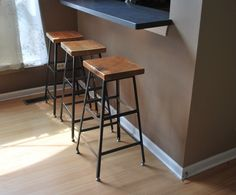 Resplendent Reclaimed Bar Stools From Square Solid Wood Seats And Black Painted Metal Legs Furniture Under Black Laminate Wood For Breakfast Bar Tops from Kitchen Design - Ideas and Picture