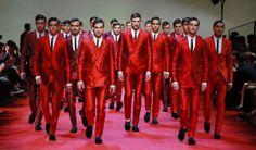 A red #army of #brutallychic, modern #matadors marched, as if to the bulls, to close the @dolcegabbana Spring 2015 #menswear show. www.dolcegabbana.com