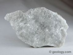 White calcite as marble: Calcite in the form of white, coarsely crystalline marble from Tate, Georgia. Specimen is about four inches (ten centimeters) across.