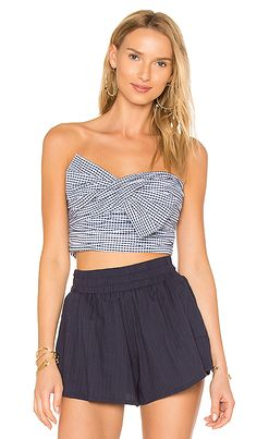 Shop for Lovers + Friends x REVOLVE Twist Turn Top in Mini Gingham at REVOLVE. Free 2-3 day shipping and returns, 30 day price match guarantee.