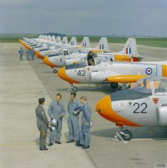 A line of BAC Jet Provost T3s at the RAF College at Cranwell, Lincolnshire, with a Flying Instructor and Flight Cadet pupils in the foreground